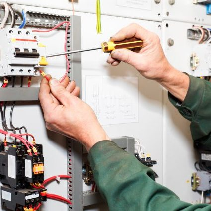 Lethbridge Electrician Working On Control Panel